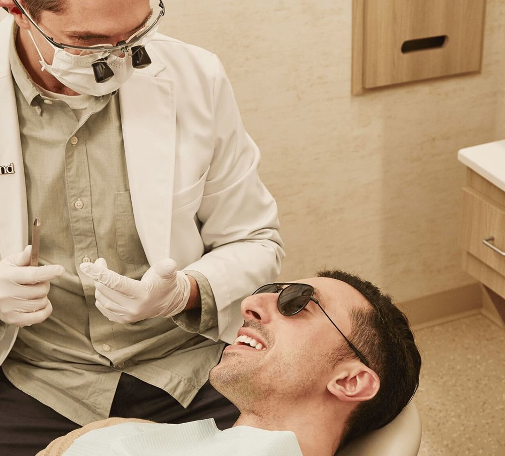 Dentist consulting with dental implant patient