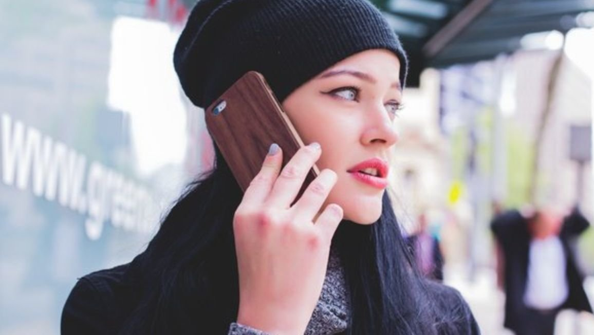 A woman talks on a cell phone
