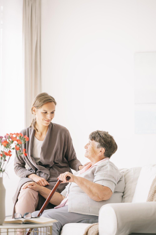 A woman comforts an elderly woman
